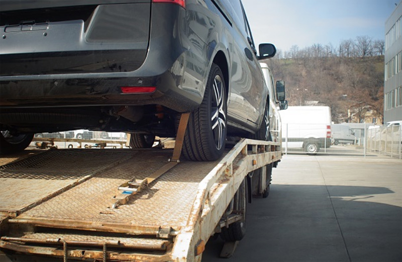 car being towed in truck bed