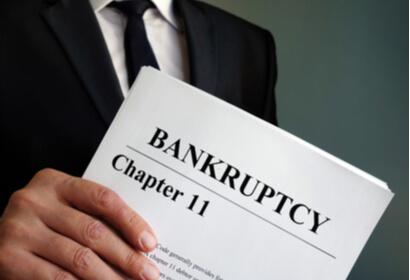 attorney holding chapter 11 bankruptcy paperwork
