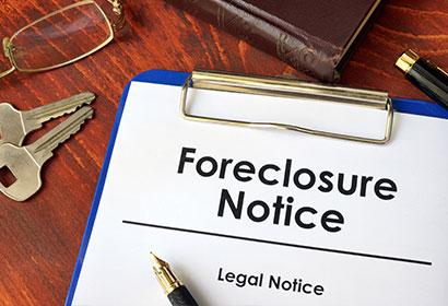 foreclosure notice on a foreclosure defense attorney desk