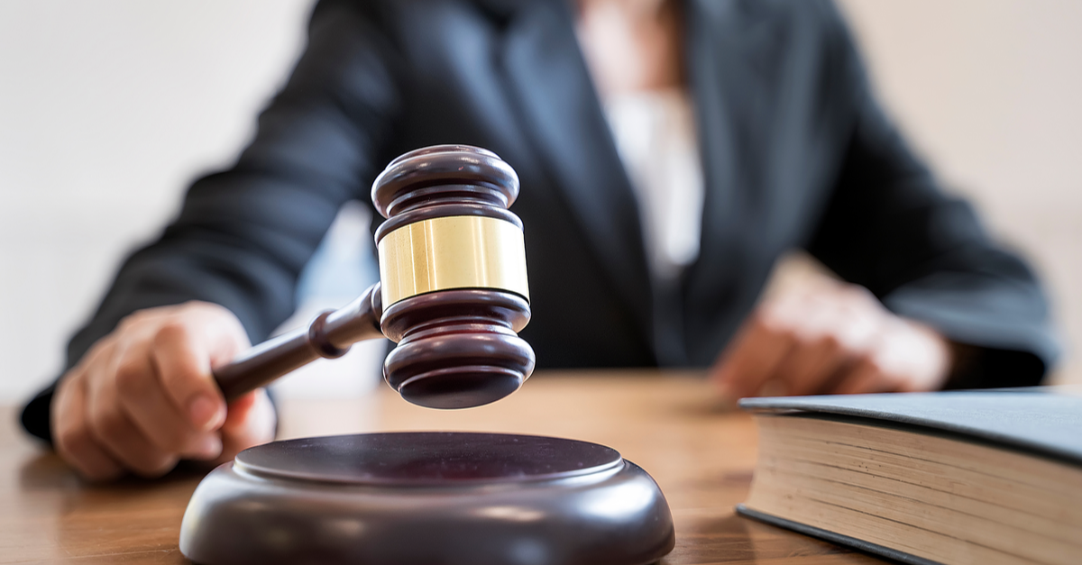 woman judge hand holding gavel bang