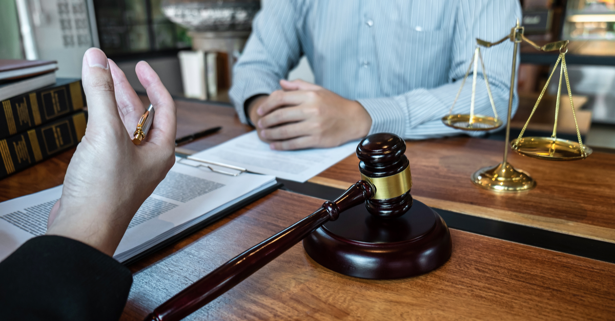 foreclosure lawyer discussing a foreclosure case with a client