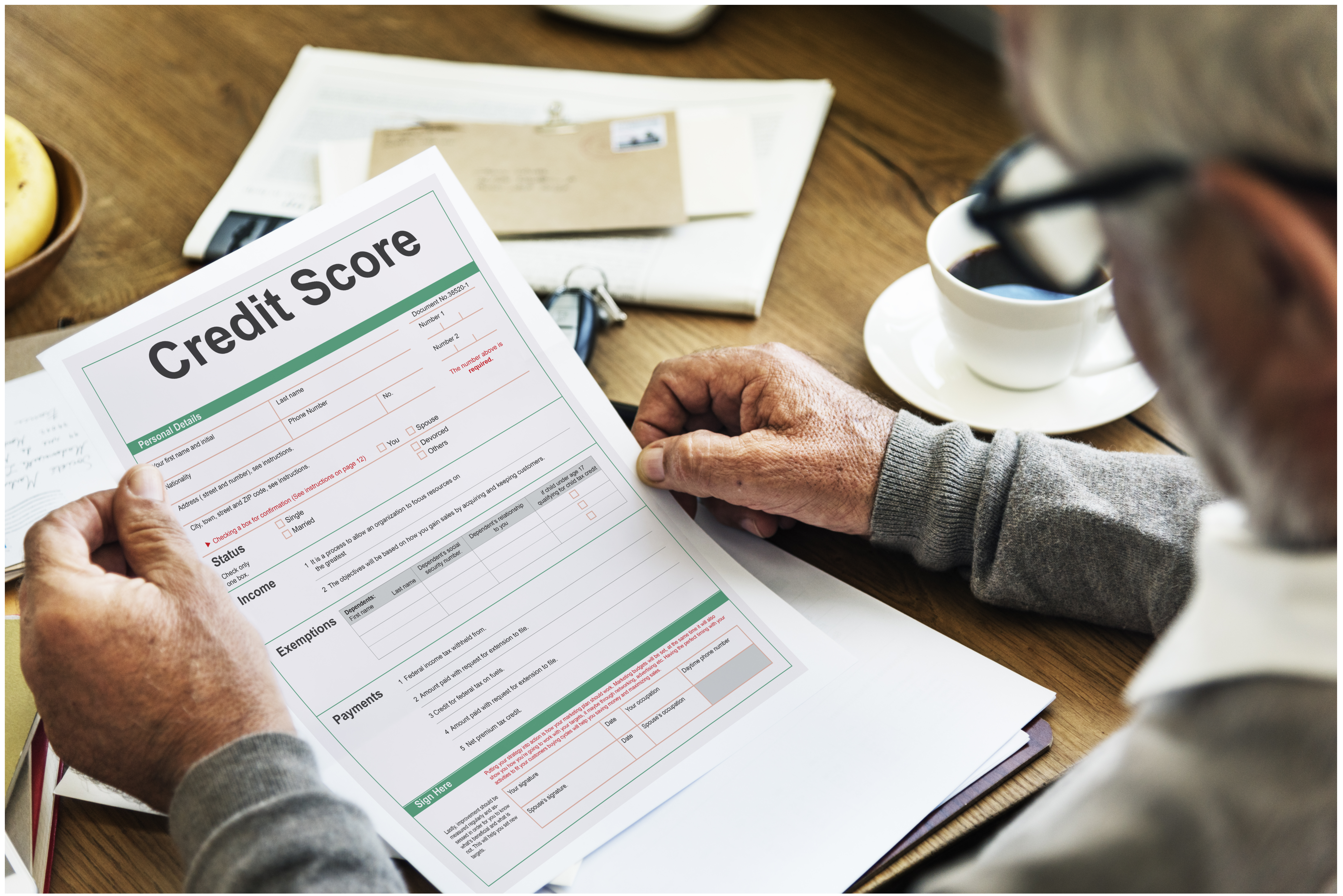 An old man looking at a credit score document