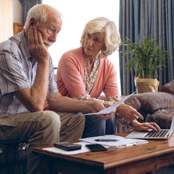 a senior couple looking at medical bills