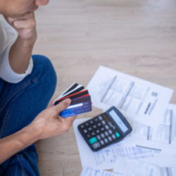man sitting stressed out about credit card debt